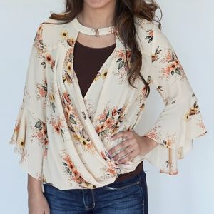 Tops - Floral surplice top with bell sleeves